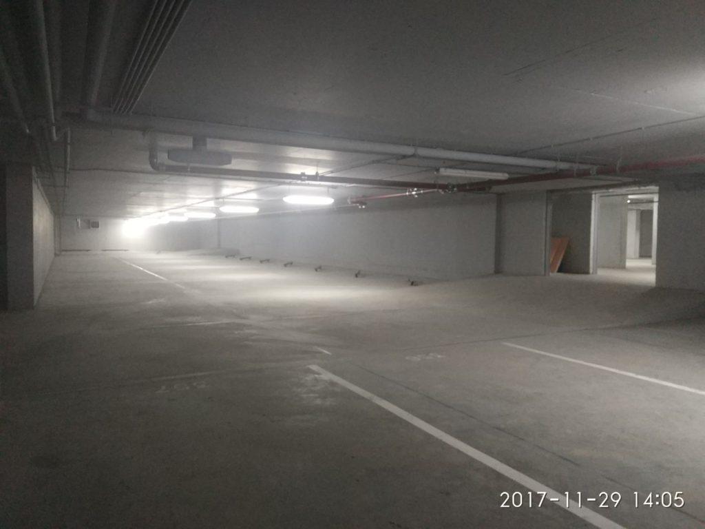 бетонный пол, упрочнённый по технологии ТОППИНГ на подземном паркинге готовый вид